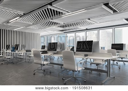 Open space office close up with gray wooden walls concrete floor and two rows of computer tables along a wall and a panoramic window. 3d rendering mock up