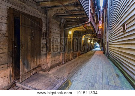 Bergen, Norway - August 14, 2016: A Narrow passage in the Bryggen district. Is a series of Hanseatic commercial buildings that has since 1979 been on the UNESCO list for World Cultural Heritage sites