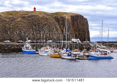 Stykkisholmur, Iceland - August 07, 2012: View of the port and the nearby basalt island. This town is situated in the western Iceland, and is the largest of the Snaefellsnes peninsula settlements