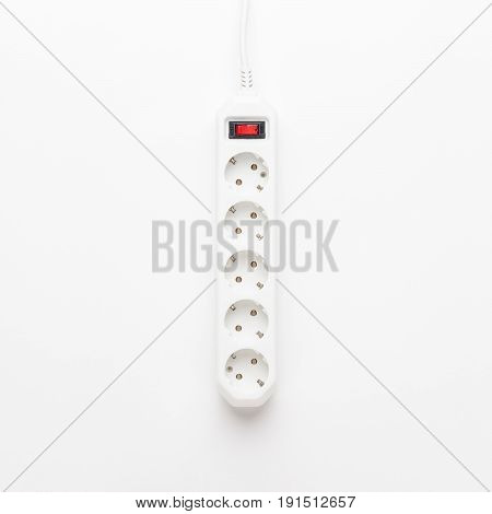 European 5-way power strip earthed on white background. not isolated