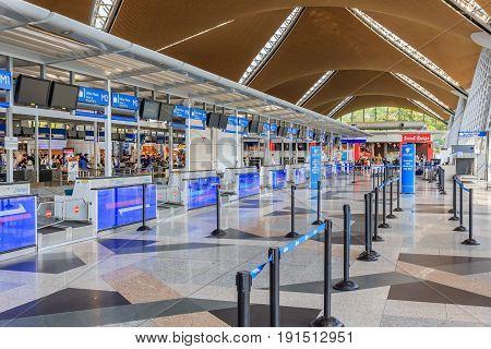 KUALA LUMPUR, MALAYSIA - APRIL 16, 2017: Check-in counters at Kuala Lumpur International Airport(KLIA1) Airport. KLIA Airport is the main international airport of Malaysia.
