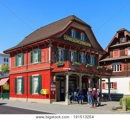 Stans, Switzerland - 7 May, 2016: people at the Stanserhornbahn funicular railroad station in the town of Stans in the Swiss canton of Nidwalden. Stanserhornbahn is a mountain funicular railway from the town of Stans to Mt. Stanserhorn.