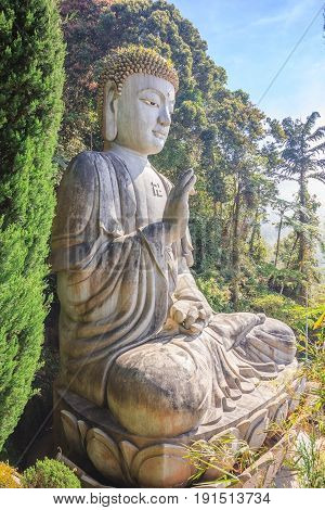 Large stone Buddha statue at Chin Swee Caves Temple in Genting Highlands Pahang Malaysia