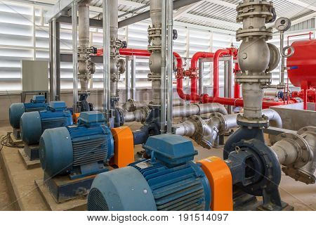 Industrial fire pump station for water sprinkler piping and fire alarm control system. Pipelines water pump valves manometers
