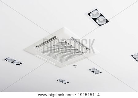 Ceiling mounted cassette type air conditioner in conference room