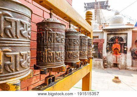 Prayer wheels at Boudhanath stupa in Kathmandu