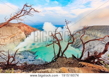 Panoramic view of Kawah Ijen Volcano at Sunrise. The Ijen volcano complex is a group of stratovolcanoes in the Banyuwangi Regency of East Java Indonesia.