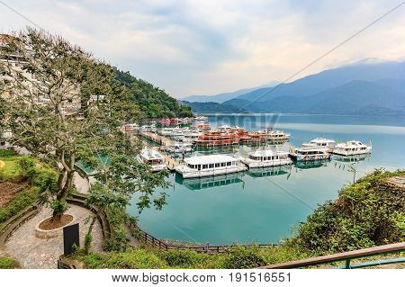NANTOU, TAIWAN - APRIL 02, 2017: Long exposure of harbor with boats in the morning time at Sun Moon Lake Nantou city Taiwan