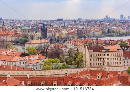 Scenic summer sunset aerial view of the Old Town pier architecture and Charles Bridge over Vltava river in Prague Czech Republic