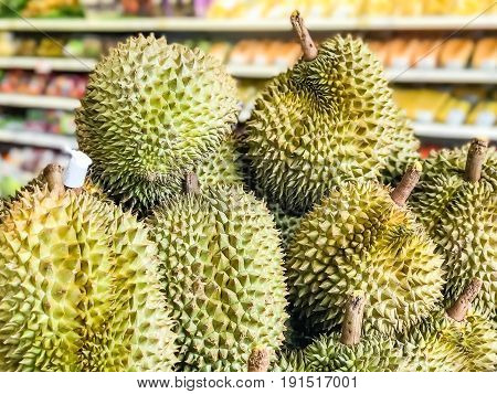 A plie of durians in a supermarket King of the fruits in Thailand.