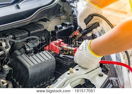 Charging car battery with electricity trough jumper cablesred and black Jumper cables