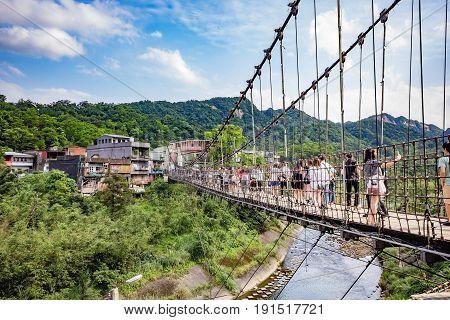 SHIFEN, TAIWAN - APRIL 30, 2017: Jingan Suspension Bridge linked between Shifen and Nanshan Village at Shifen Taiwan