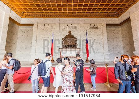 TAIPEI, TAIWAN - APRIL 29, 2017: Visitors at the Chiang Kai-Shek Memorial Hall in Taipei. Chiang Kai-shek Memorial Hall is a popular travel destination among tourists visiting Taiwan.