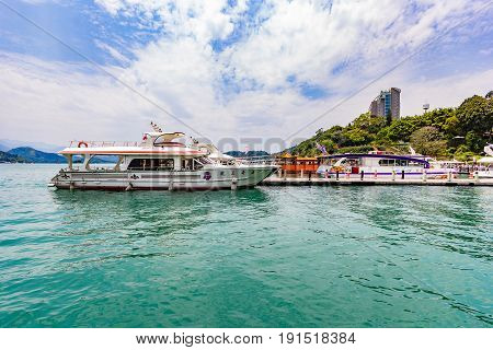 NANTOU, TAIWAN - APRIL 01, 2017: Boats parking at the pier at Sun Moon Lake Taiwan. Sun Moon Lake is the largest body of water in Taiwan as well as a tourist attraction.