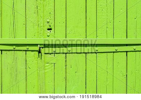 Old painted wooden garage door of green color