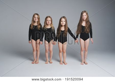 four young beautiful models with long hair
