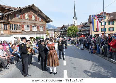 People Wearing Traditional Clothes And Playing Music Of Switzerland