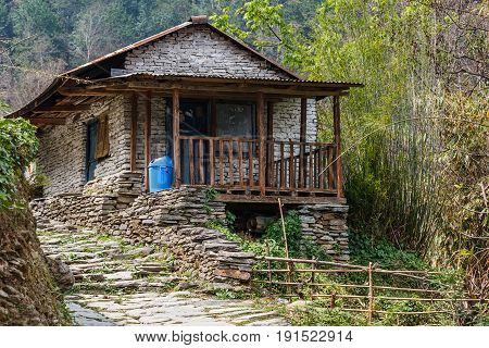 Photo of stone building in the mountains