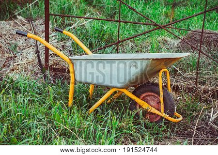 A trolley for building in the garden stands on the grass