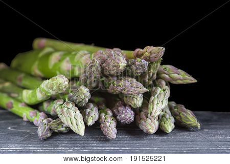Green Asparagus On A Black Background