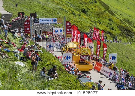 Pas de Peyrol, France - July 6, 2016: Mc Cain Caravan during the passing of the Publicity Caravan on the road to Pas de Pyerol (Puy Mary) in the Central Massif during the stage 5 of Tour de France on July 6 2016.