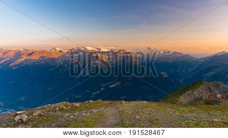 Last Soft Sunlight Over Rocky Mountain Peaks, Ridges And Valleys Of The Alps At Sunrise. Extreme Ter