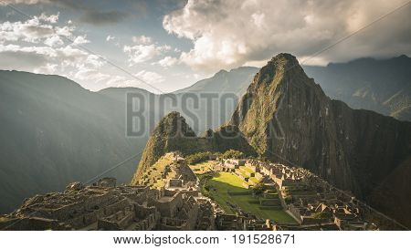 Machu Picchu Archeological Site, Wide Angle View From The Terraces Above With Scenic Sky. Toned Imag