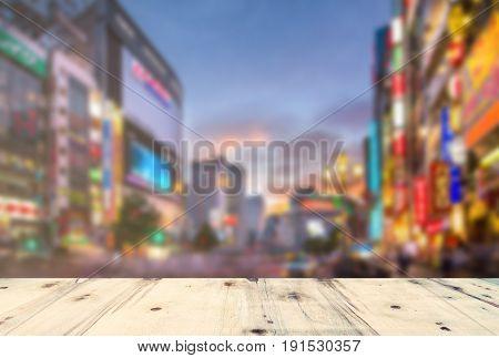 wooden platform and lights of night Tokyo , Japan