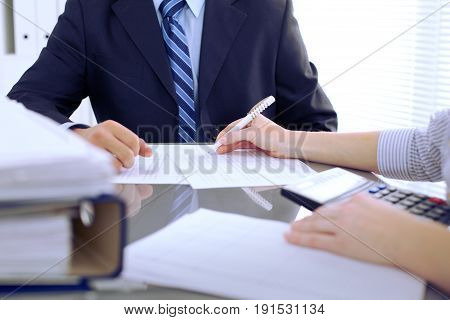 Bookkeepers or financial inspector making report, calculating or checking balance. Audit concept