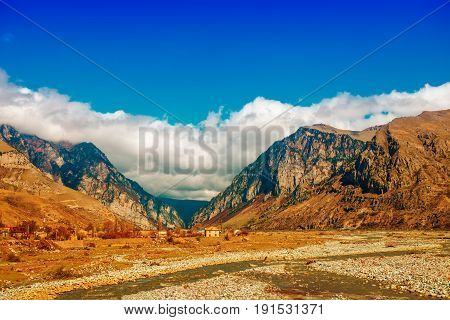 Rural Province Scene Of Spring Village With Ravine Mountain Caucasus And River, Russia, Republic Ing