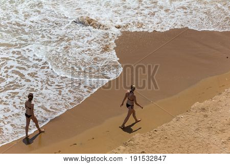 LAGOS, PORTUGAL - APRIL 23, 2017: People at the famous beach of Praia Dona Ana in Lagos, Algarve region, Portugal