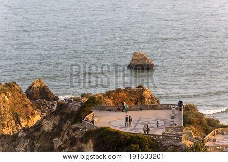 PRAIA DA ROCHA, PORTUGAL - APRIL 22, 2017: People at Miradouro of Praia da Rocha in Portimao. This beach is a part of famous tourist region of Algarve.
