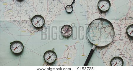 Compass and magnifier on a map