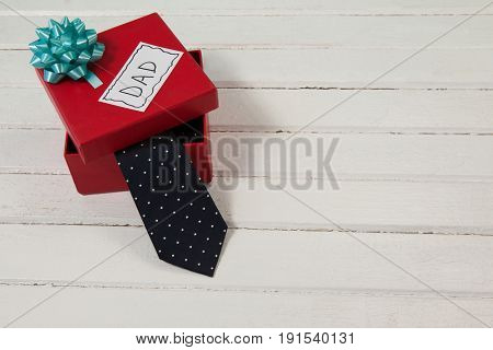 High angle view of gift box with dad text on table