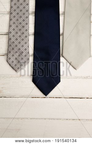 High angle view of neckties on wooden table