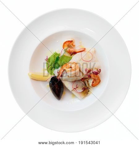 Fish fillet with seafood, isolated on white background
