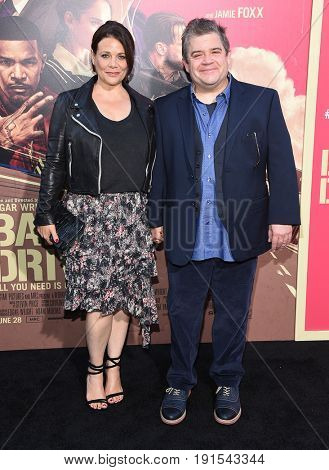 LOS ANGELES - JUN 14:  Meredith Salenger and Patton Oswalt arrives for the