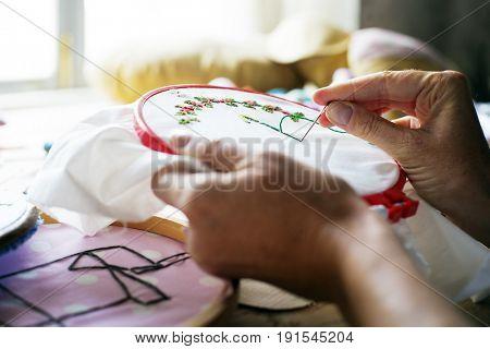 Closeup of hands sewing embroidery handicraft handmade