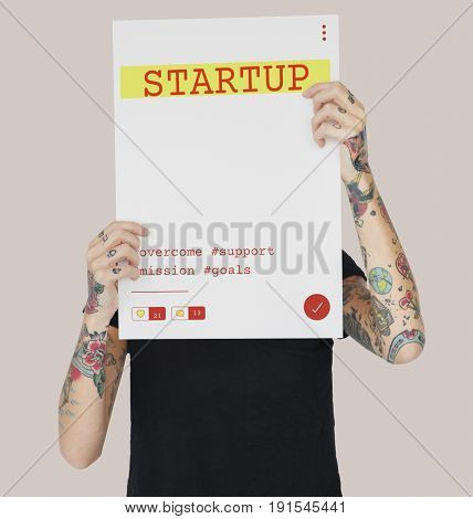 Tattooed girl holding investment startup plan marketing strategy banner