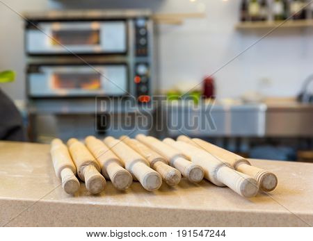 Wooden rolling pin on the table closeup