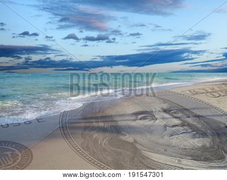 conceptual image of one hundred US dollar bill on sandy beach