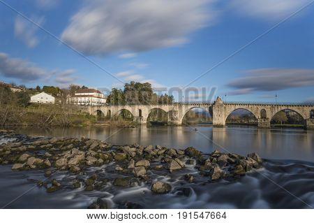 Long exposure at ancient bridge of Ponte da Barca - Portugal