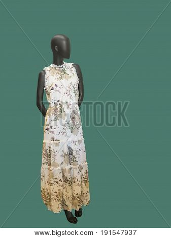 Full-length female mannequin wearing floral dress. Isolated on white background. No brand names or copyright objects.