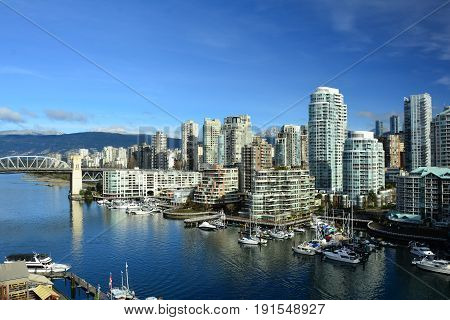 Vancouver BC, Canada, February 20th 2017.High rise condo buildings at False Creek in Vancouver.One part of the large skyline of Vancouver.