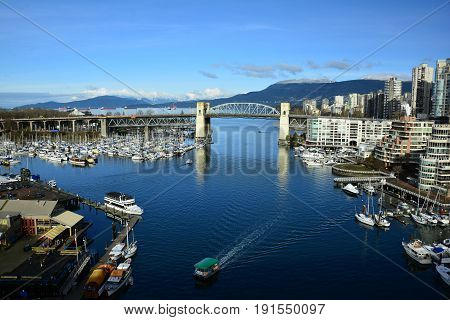 Vancouver BC, Canada, February 20th 2017.The skyline of Vancouver with False Creek and Granville island Come explore Vancouver and take home life long memories.