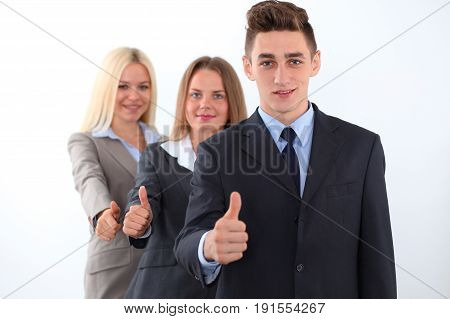 Group of business people, thumbs up. Business concept