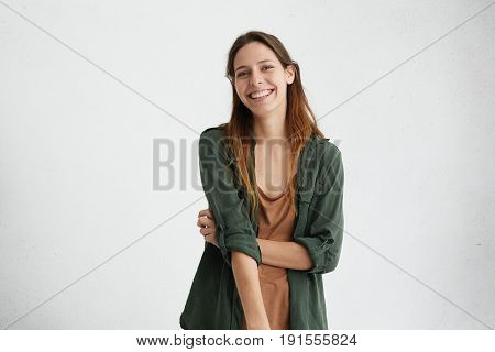 Carefree Student Female Dressed In Green Jacket Having Appealing Appearance Looking With Positive Ex