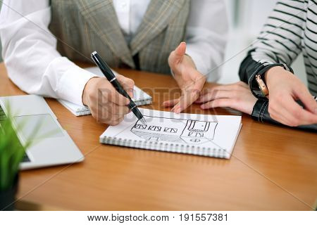 Young business woman designer discussing architecture project with client in office. Successful startup business concept