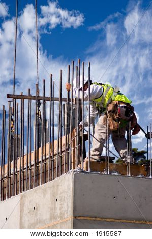 High Wall Worker Against Clouds