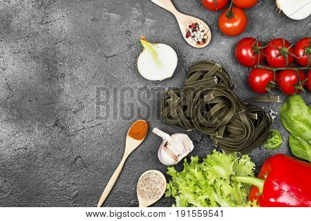 Raw Pasta Of Tagliatelle With Spinach And Ingredients For Cooking (cherry Tomatoes, Spices, Garlic,